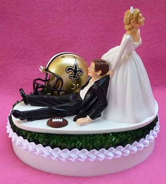 New Orleans Saints cake topper wedding NOLA football NFL sports fans fun bride dragging groom humorous turf green