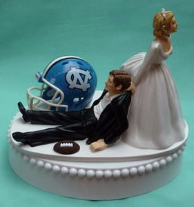 University of North Carolina wedding cake topper UNC Tar Heels football groom's cake top humorous sports fans funny ball helmet reception gift bride dragging groom Fun Wedding Things
