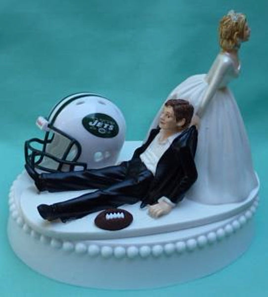 New York Jets wedding cake topper NY football bride dragging groom NFL sports fans fun reception helmet ball