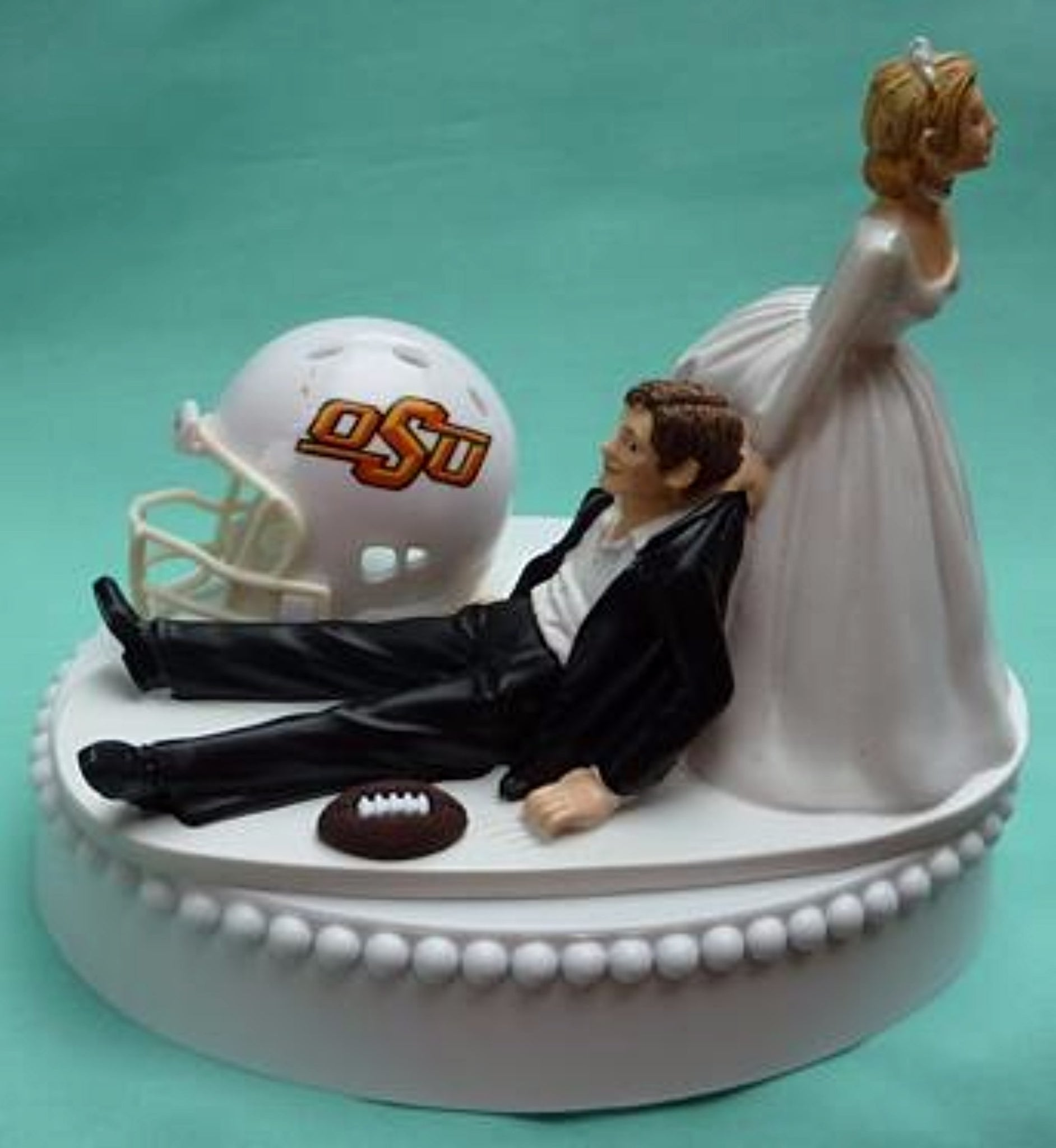 Oklahoma St. University wedding cake topper OSU Cowboys football State sports themed humorous funny bride dragging groom groom's cake top helmet ball reception gift Fun Wedding Things