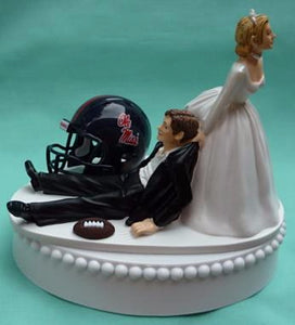 University of Mississippi wedding cake topper Ole Miss Rebels football groom's cake top funny humorous bride dragging groom helmet ball sports fans Fun Wedding Things reception gift