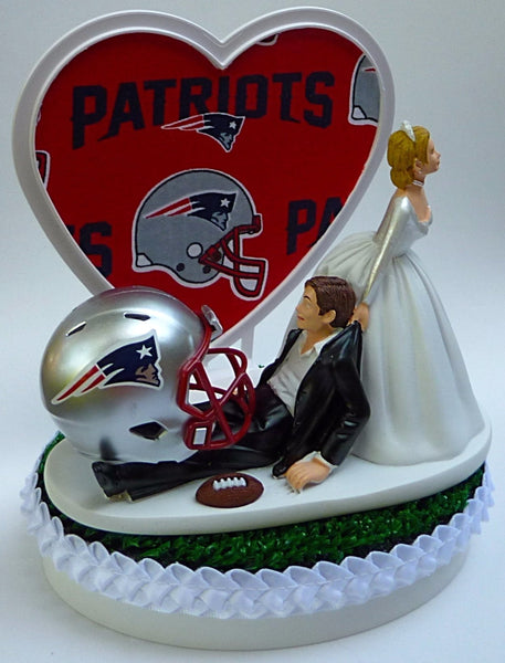 New England Patriots cake topper wedding groom's top NFL football bride dragging groom humorous funny