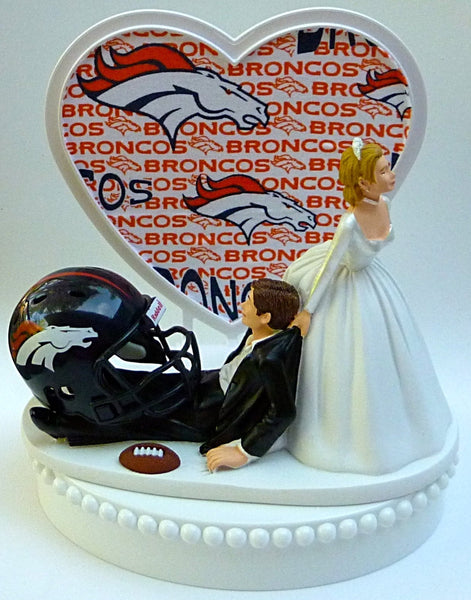 Denver Broncos cake topper wedding football fans bride dragging groom NFL sports humorous funny reception FunWeddingThings.com