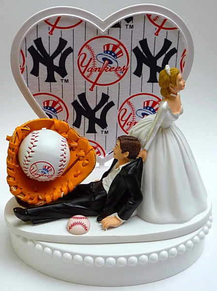 NY Yankees wedding cake topper New York MLB baseball sports fans fun bride dragging groom away humorous unique funny