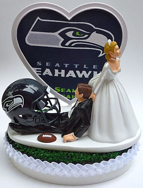 Seattle Seahawks wedding cake topper NFL football sports fans bride drags groom humorous