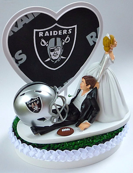 Oakland Raiders wedding cake topper football NFL fans sports bride drags groom humorous funny FunWeddingThings.com