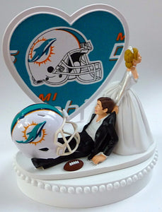 Miami Dolphins cake topper wedding NFL sports fans bride dragging groom football humorous funny