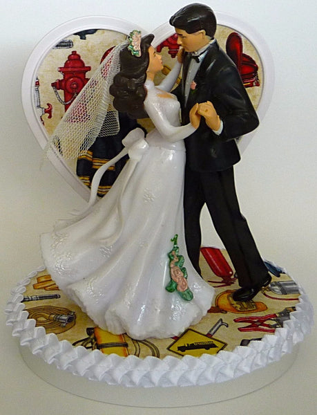 Fire dept wedding cake topper FunWeddingThings.com fireman firefighter pretty bride groom dancing