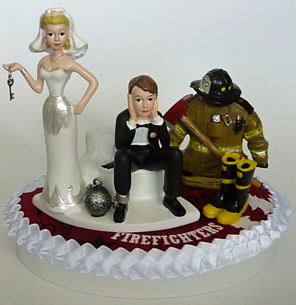 Humorous firefighter wedding cake topper FunWeddingThings.com fireman bride groom