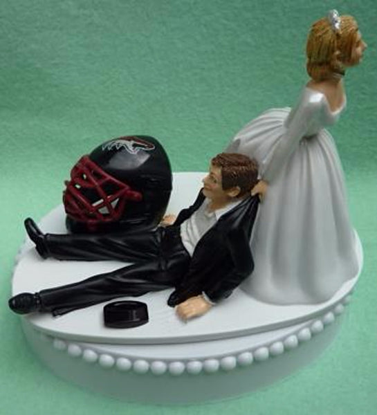 Arizona Coyotes cake topper wedding NHL hockey fans bride dragging groom's cake top humorous sporty funny puck helmet mask Fun Wedding Things reception gift item idea