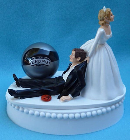 San Antonio Spurs wedding cake topper basketball fans fun NBA groom's cake top bride dragging groom humorous FunWeddingThings.com reception gift item idea