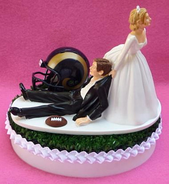 Los Angeles Rams cake topper wedding football bride dragging groom humorous fun FunWeddingThings.com