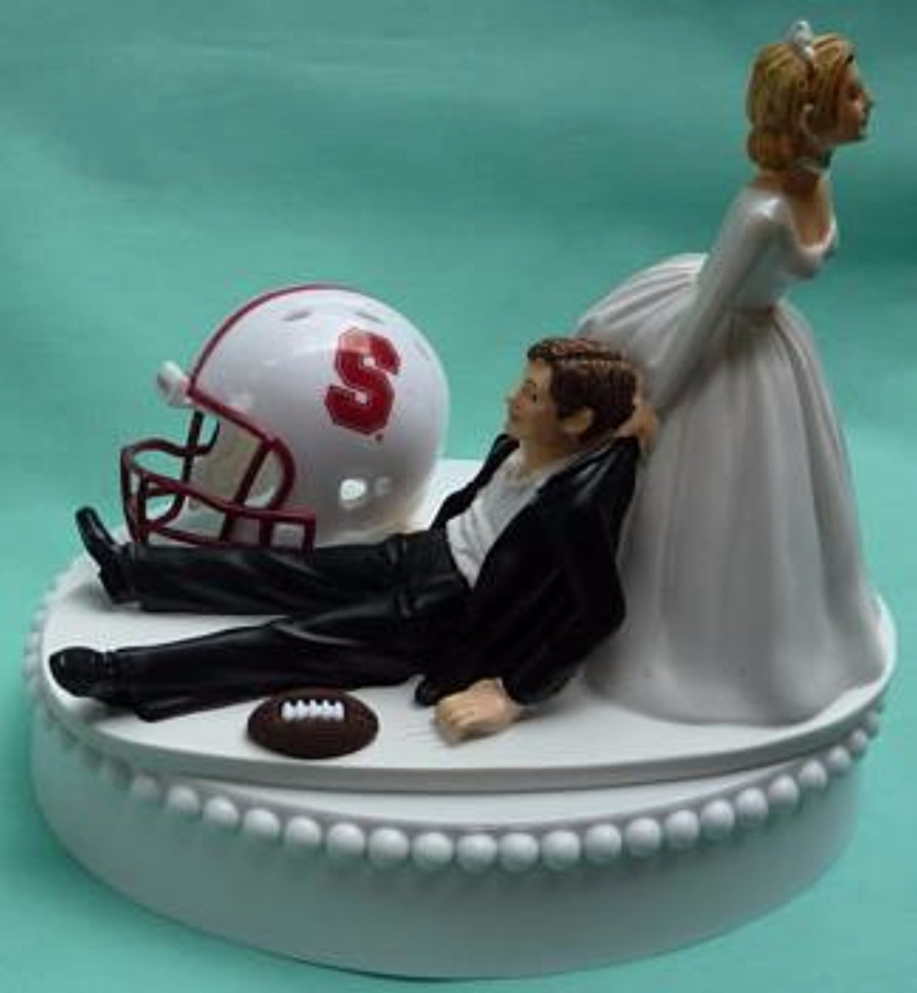 Stanford University wedding cake topper Cardinal football groom's cake top humorous bride dragging groom funny sports fans reception Fun Wedding Things