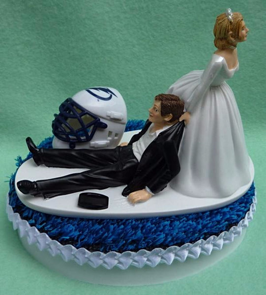 Tampa Bay Lightning cake topper wedding hockey groom's cake top NHL sports bride drags groom humorous reception blue turf ice helmet puck Fun Wedding Things