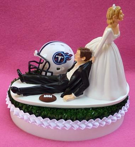 Tennessee Titans wedding cake topper NFL football bride dragging groom humorous funny sports reception