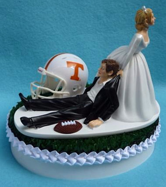 University of Tennessee Volunteers wedding cake topper UT Vols football humorous bride dragging groom sports fans green turf ball helmet unique gift Fun Wedding Things reception