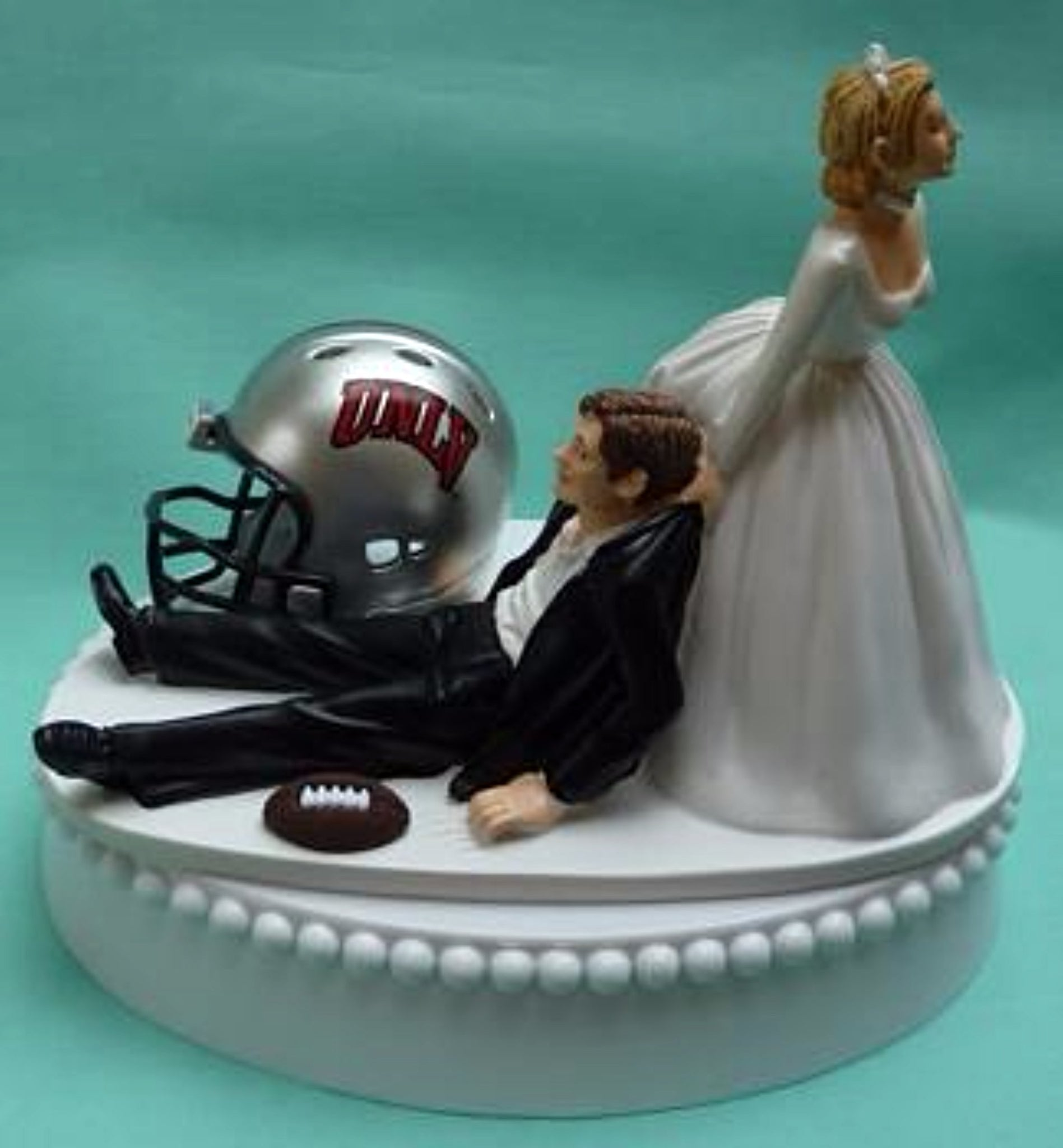 University of Nevada Las Vegas wedding cake topper UNLV Rebels football groom's cake top humorous bride dragging groom funny reception gift Fun Wedding Things
