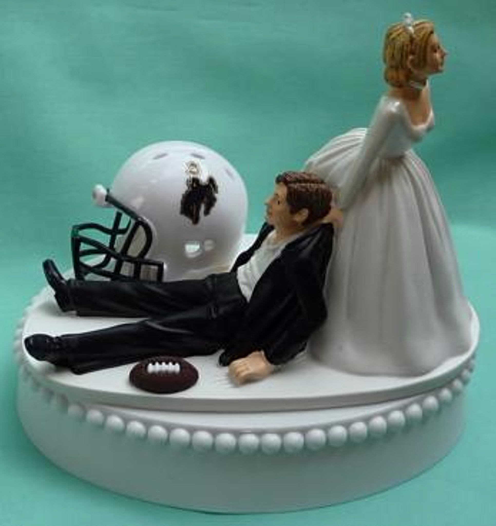 University of Wyoming wedding cake topper UW Cowboys football groom's cake top humorous funny bride dragging groom ball helmet unique reception gift Fun Wedding Things