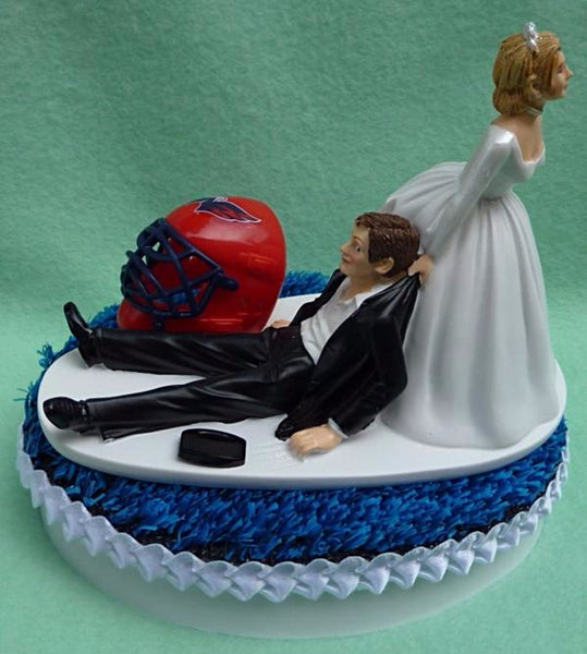 Washington Capitals cake topper wedding Caps NHL hockey sports fans bride dragging groom groom's cake top humorous funny Fun Wedding Things