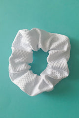White scrunchy for stylish tennis players