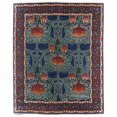Blue and red hand knotted rug