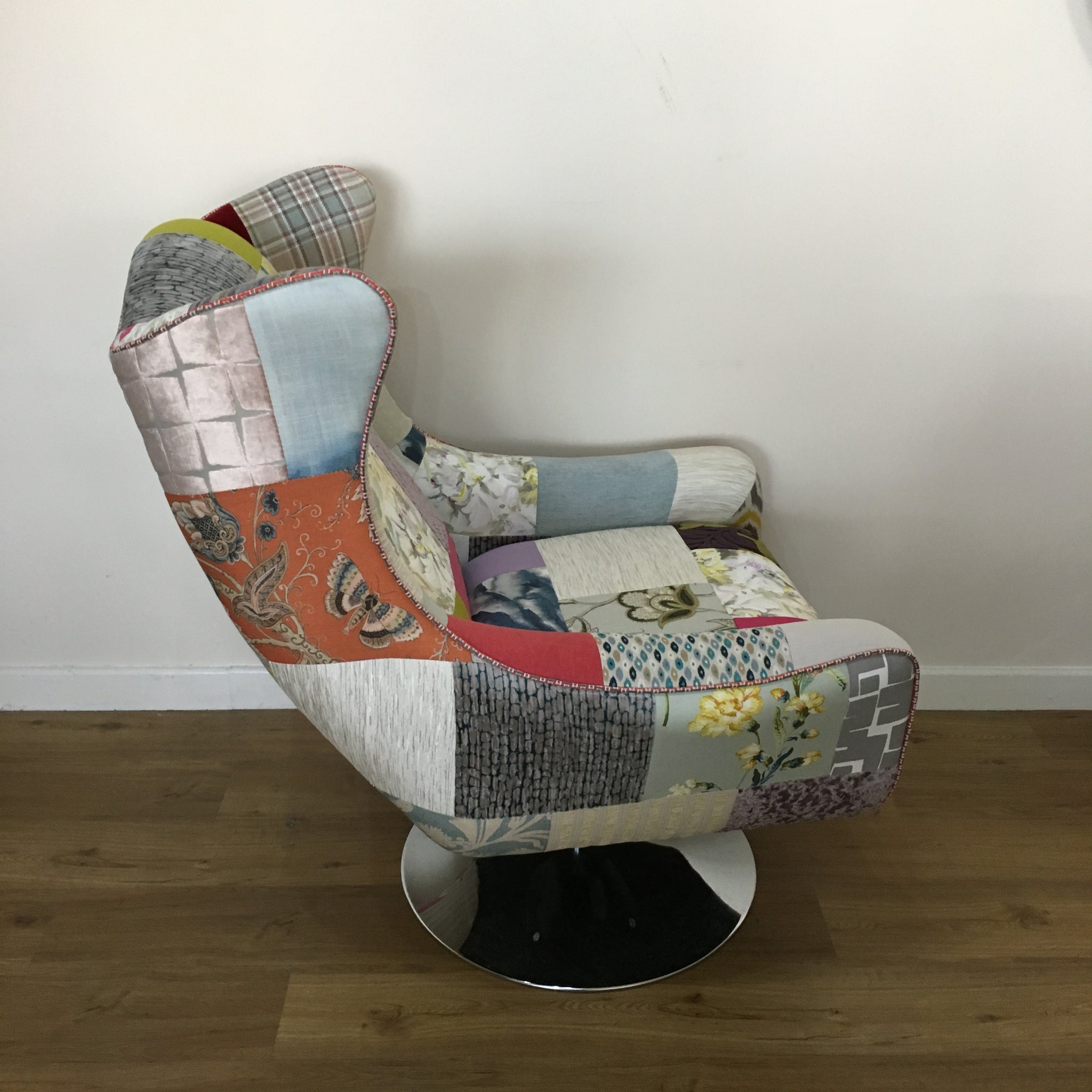... Space Swivel Wing Chair