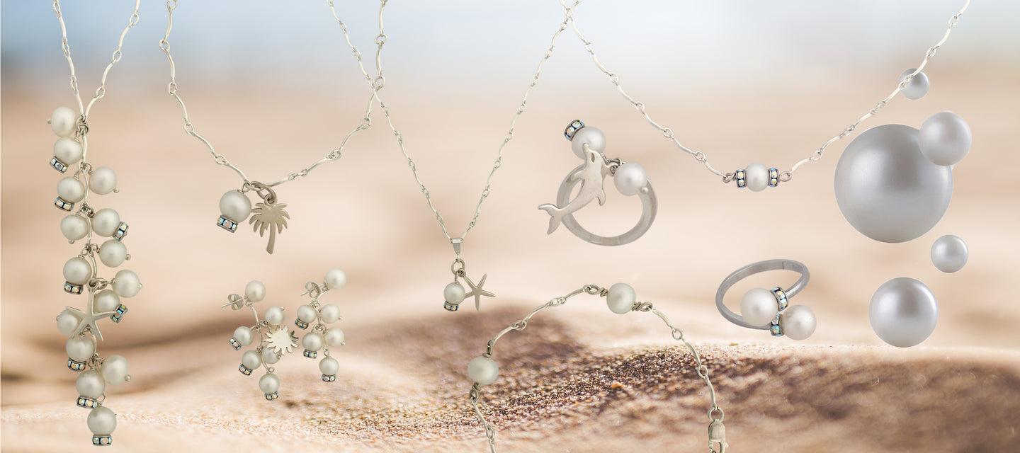 Colletion of sea inspired jewelry in pearls silver and Swarovski