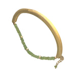 Gold plated bangle with peridot strand
