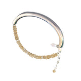 Rhodium plated bangle with citrine strand