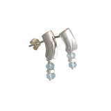Rhodium plated and blue topaz dangling earrings