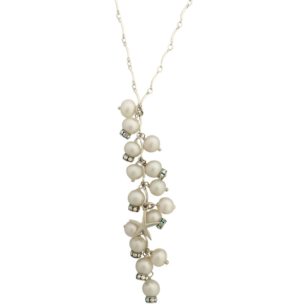 Necklace with multiple pearls pedant and one sea inspired charm in a silver chain