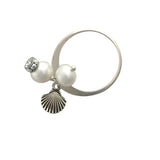 Silver ring with pearls and shell charm