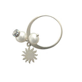 Silver ring with pearls and sun charm
