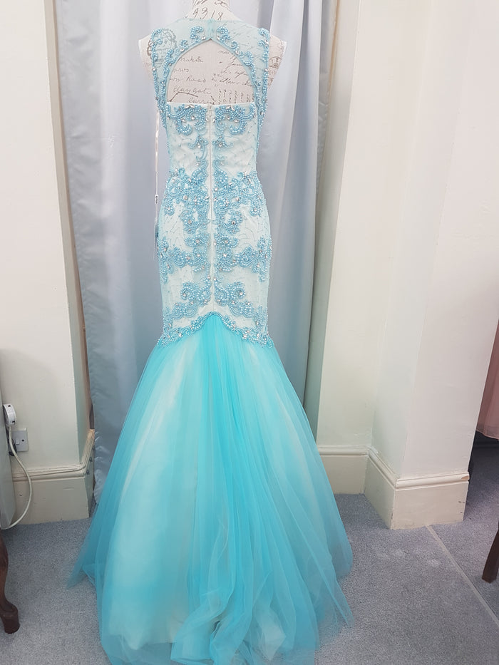 Stunning Baby Blue fishtail with fitted body that is adorn with pearls and rhinestones
