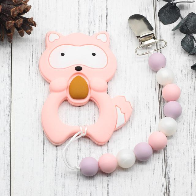 Baby Teether & Pacifier with Safety Holder | Freaky Inventions