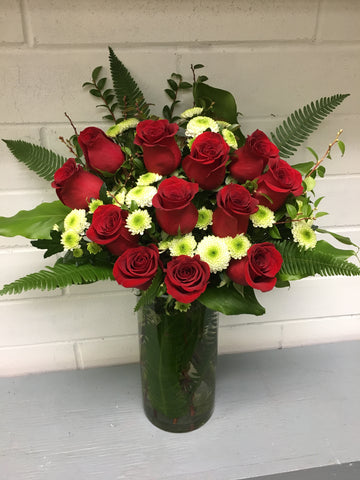 Dozen Red Roses In A Vase With Filler