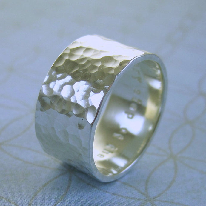Wider hammered sterling silver ring