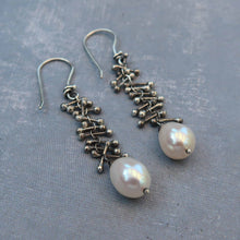Sterling silver earrings with white pearls