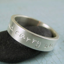 silver ring with inscription