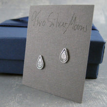 Little ornament stud earrings with packaging
