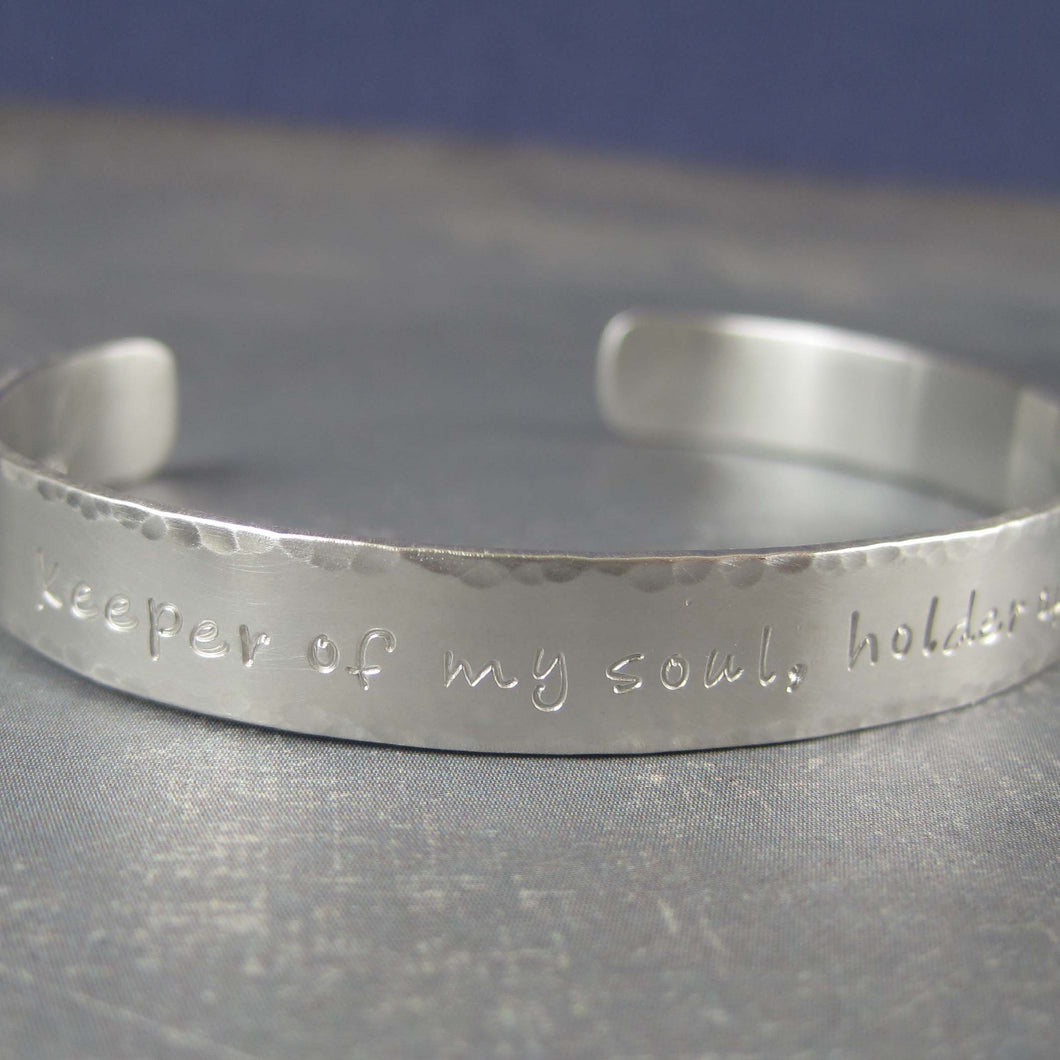 custom inscription on silver bracelet