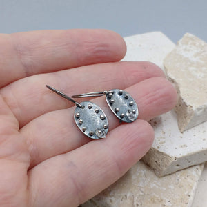 Metalwork moon pebble earrings