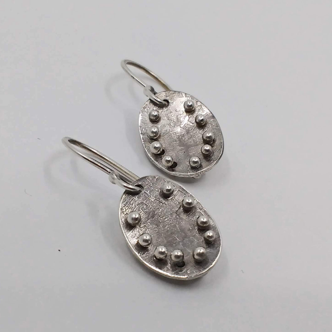 Oval studded earrings