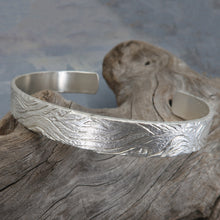 Carved woodgrain silver cuff
