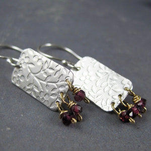 Floral pattern dangle earrings with garnets
