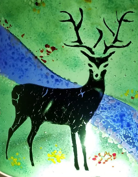 Deer painted on glass