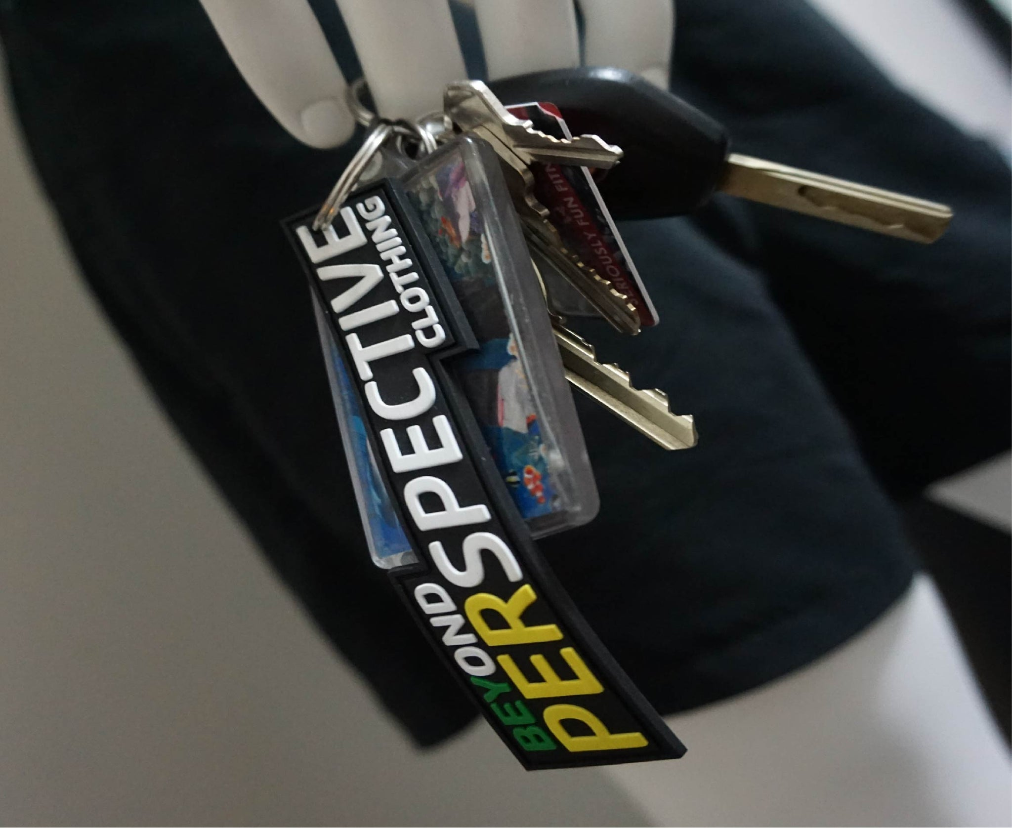 BEYOND PERSPECTIVE CLOTHING KEYRING