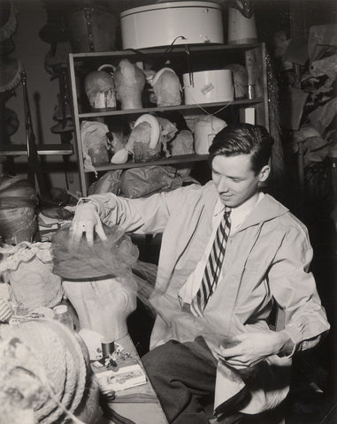 Bill Cunningham is making a hat at his millinery shop in New York in 1956.