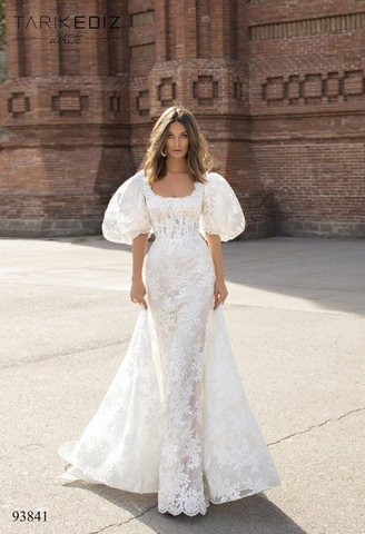 Another beautiful example of a scoop neckline type. A model is wearing a big puffy maxi dress, it's breathtaking!