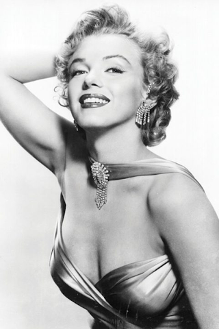 Marilyn Monroe is wearing a sweetheart dress that made her famous.